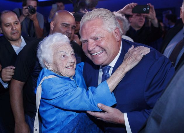 Ontario Premier Doug Ford is congratulated by former Mississauga mayor Hazel McCallion in Toronto after...