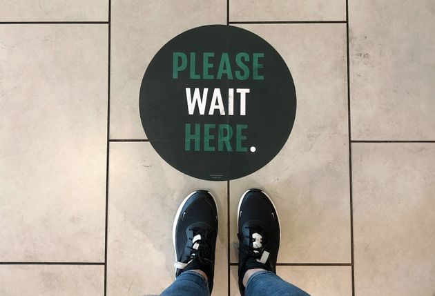 A social distancing measure sticker on the floor inside a