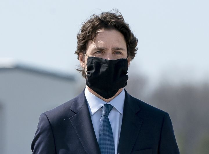 Prime Minister Justin Trudeau wears a mask at a repatriation ceremony on May 6, 2020 at CFB Trenton, Ont. for the six Canadian Armed Forces members killed in a helicopter crash off of Greece.