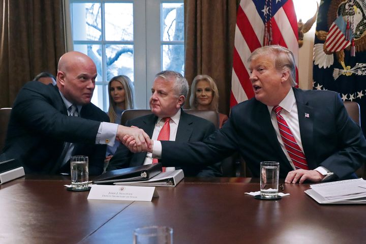 Donald Trump shakes hands with Matthew Whitaker during a Cabinet meeting on Feb. 12, 2019.