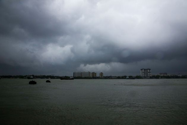 Rain clouds hover over the Hooghly River in Kolkata, India, Wednesday, May 20,