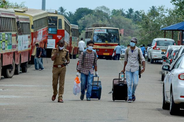 Indian citizens evacuated from Maldives on a special ship being shifted to a quarantine centre by bus...