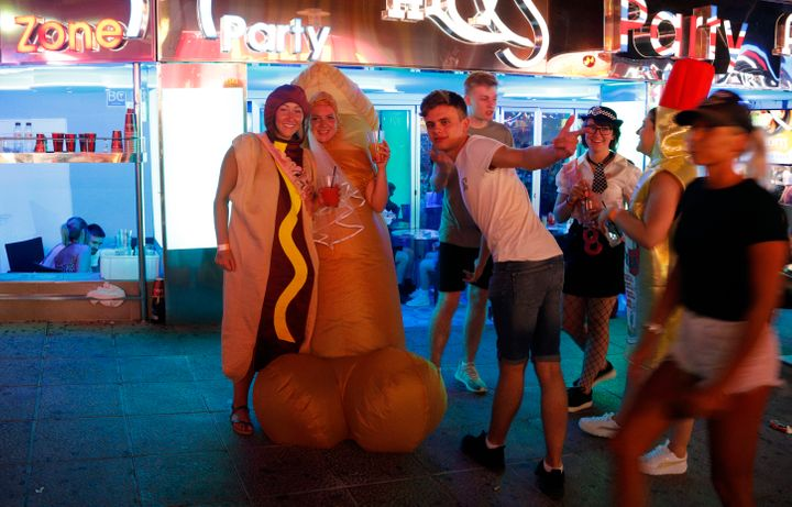 Holidaymakers on the Punta Ballena strip in Magaluf, Spain
