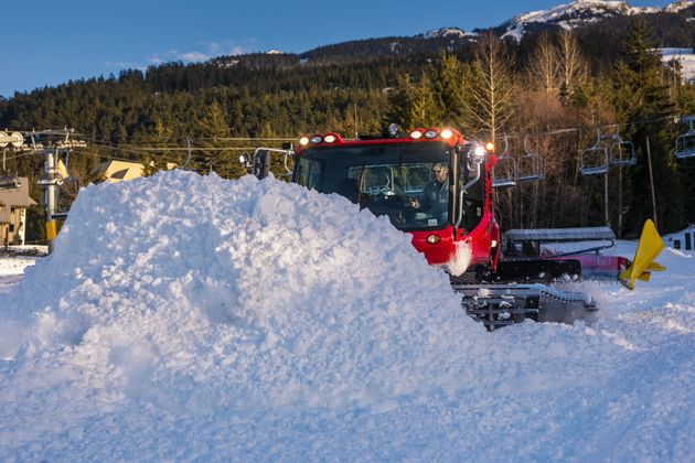 A snow cat operates beside a massive pile of snow at Blackcomb Mountain in Whistler, B.C., on Nov. 27,...