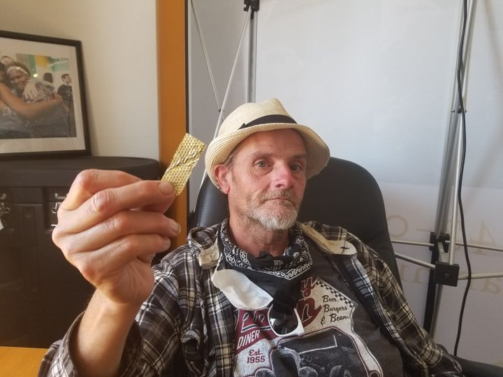 """Derek """"D-Rock"""" Williams with a piece of the golden glitter from the """"America's Got Talent"""" audition."""