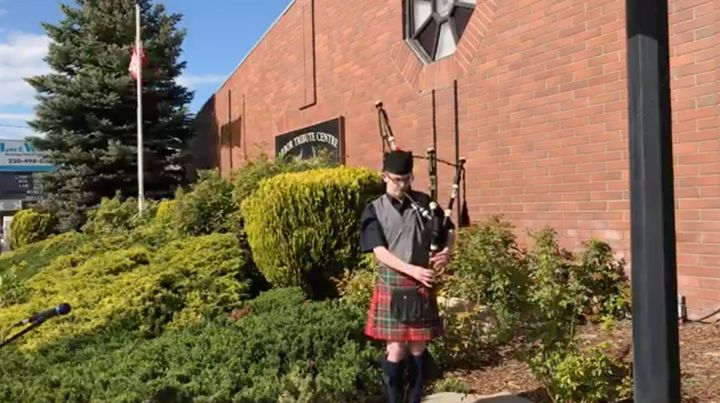 Seamus Grant plays outside Providence Funeral Home in Penticton, B.C. on May 15, 2020.