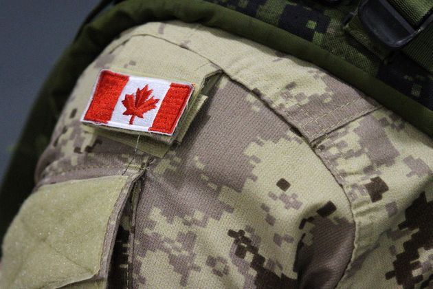 A Canadian flag is shown on the arm of a Canadian Forces member in Trenton, Ont., on Oct. 16,