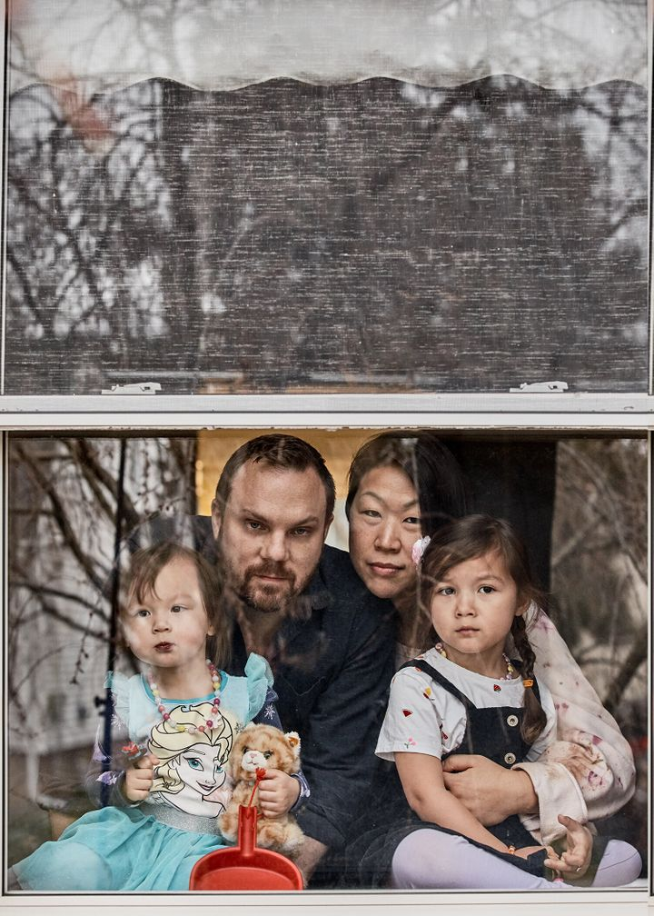 Michael Oliverio (left) and Barbara Kwon with their two daughters, ages 4 and 2.