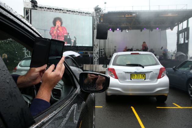 SYDNEY, AUSTRALIA - MAY 21: A man in a car takes a selfie as Casey Donovan performs on stage during a...