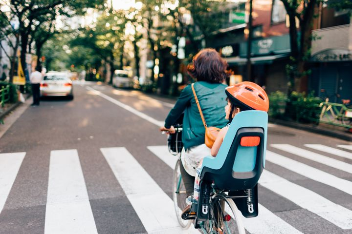 Mother on the way home by bicycle with her child, Tokyo
