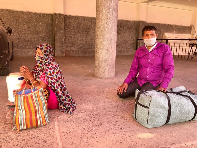 Bal Mukund and his wife Manju, migrant workers from Bihar, in a medical screening queue in Chhatarpur,...
