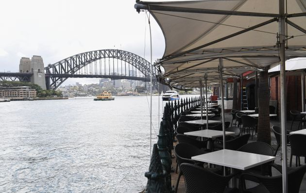 Restaurants and cafes shut down in Circular Quay on March 23, 2020 in Sydney, Australia. F(Photo by James...