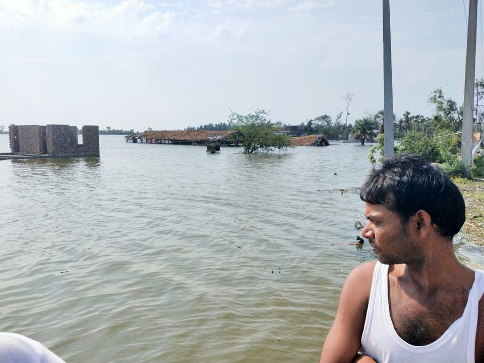 A man looks over at a stretch of agricultural land inundated by flood water after rivers breached banks...