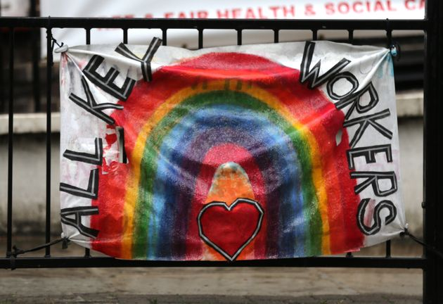 A rainbow banner in tribute to the work of key workers is displayed outside the Royal Free Hospital in
