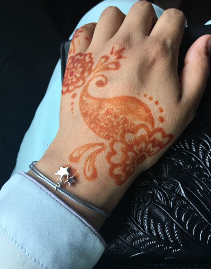 Raisah Ahmed shows her henna-painted hands at a previous Eid