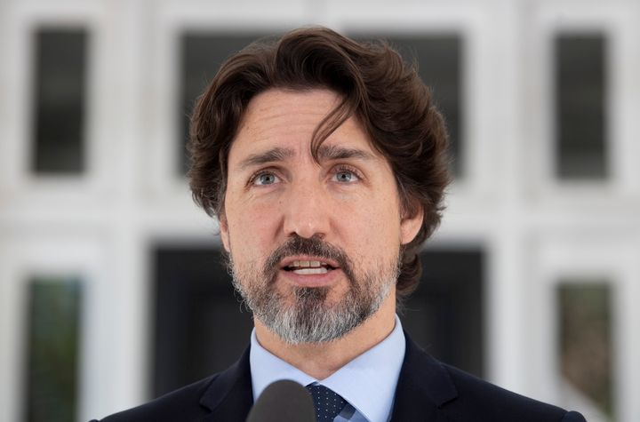 Prime Minister Justin Trudeau responds to a question from the media during a daily news conference outside Rideau Cottage on May 22, 2020.