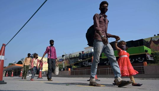 Away From Cameras, Migrant Workers Are Undertaking Perilous Journeys Back