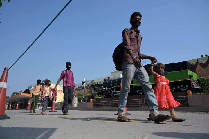 Prayagraj: Migrant workers stranded in Gujrat arrived from a special train during a government-imposed nationwide lockdown as a preventive measure against the COVID-19 coronavirus, in Prayagraj on May 6, 2020.