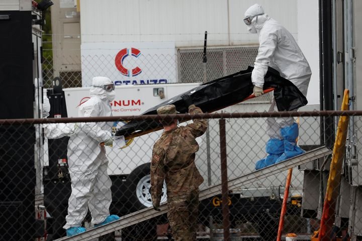 Workers move a deceased coronavirus patient in New Jersey.