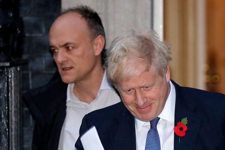 Britain's Prime Minister Boris Johnson, right, and advisor Dominic Cummings, left. Cummings is accused of flouting coronaviru