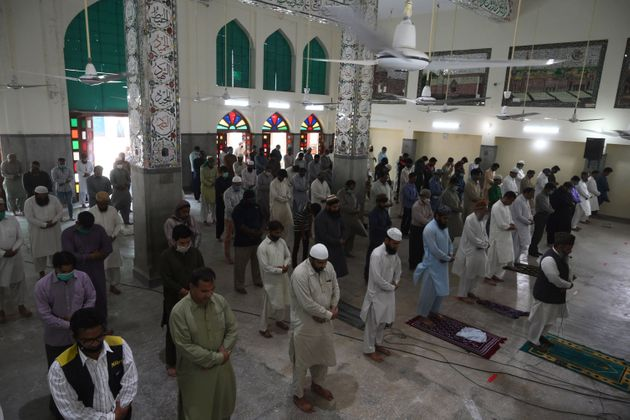 Muslim devotees offer Friday prayers at a mosque during the Islamic holy month of Ramadan in Lahore on...