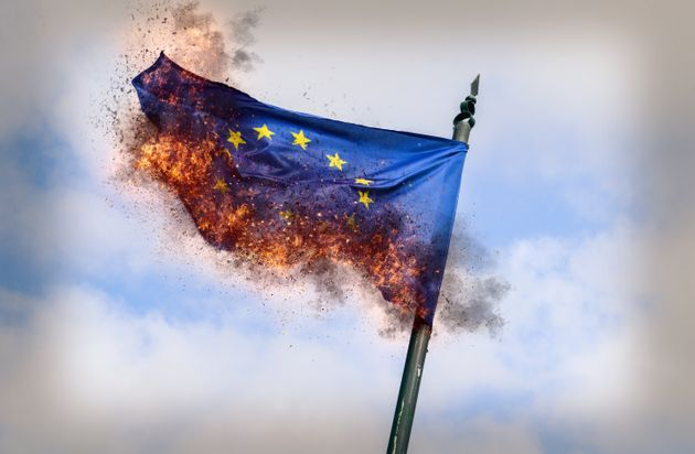 Flag of European Union burning with ashes - conceptual for breakup of the trading bloc and euroscepticism...