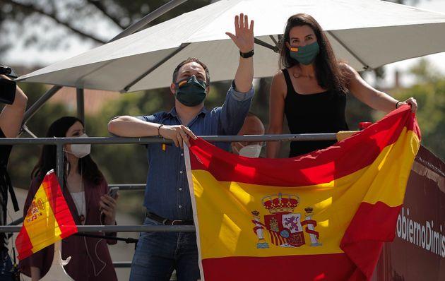 Los dirigentes de Vox Santiago Abascal y Rocío Monasterio, en la marcha contra el