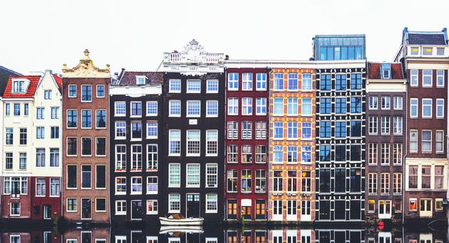 Typical Dutch houses built by the canal, Amsterdam,