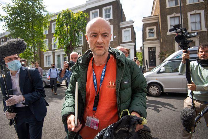 Britain's Prime Minister Boris Johnson's senior aid Dominic Cummings leaves his home, in London, Sunday, May 24, 2020. (Victoria Jones/PA via AP)