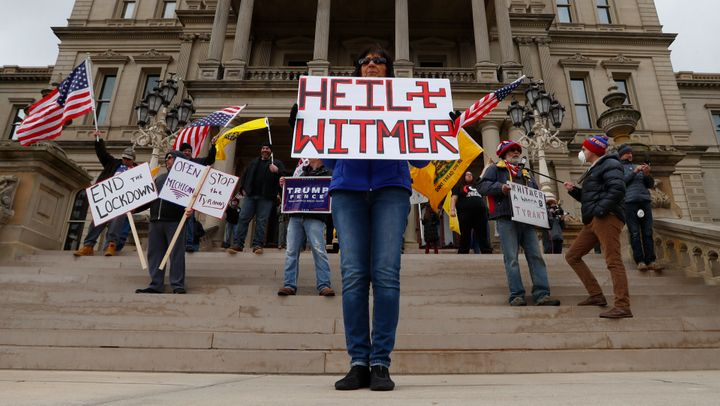 Protesters at the Michigan State Capitol building in Lansing, Michigan.