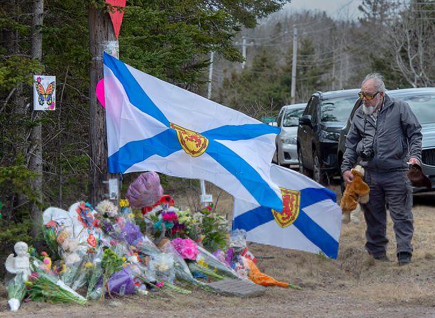 A man pays his respects at a roadside memorial in Portapique, Nova Scotia, following the mass shootings...