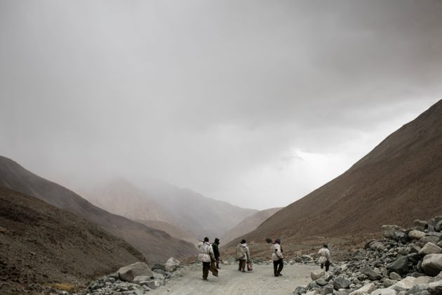In this picture taken on May 18, 2019, road maintenance workers seen near Pangong Lake road near the...