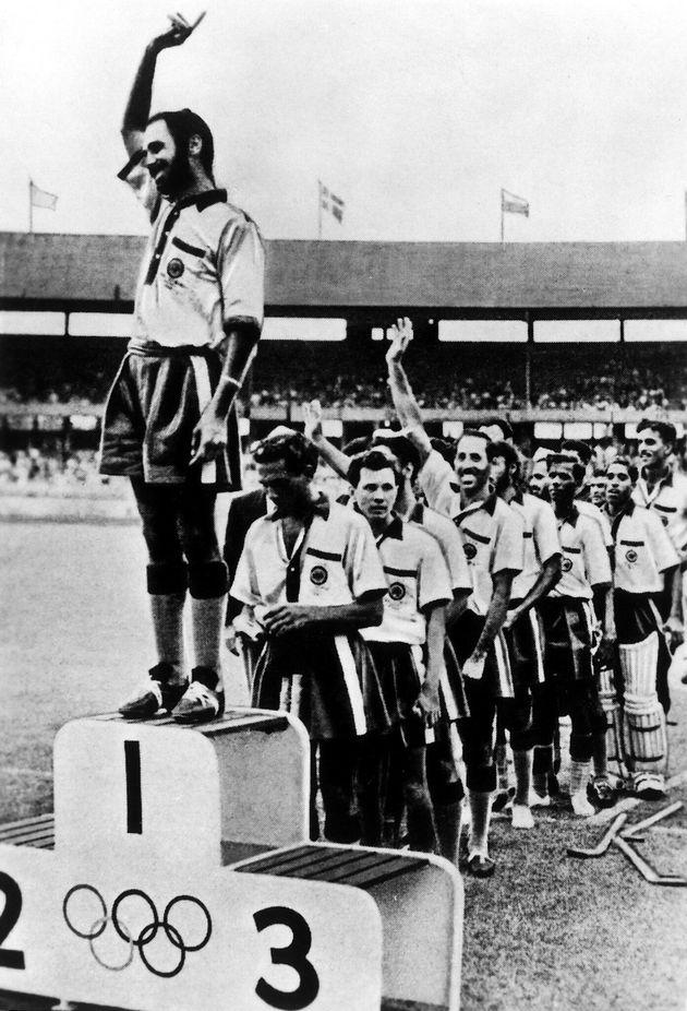 Field hockey, men: award ceremony for the winning Indian team, captain Balbir Singh on the winner's rostrum...