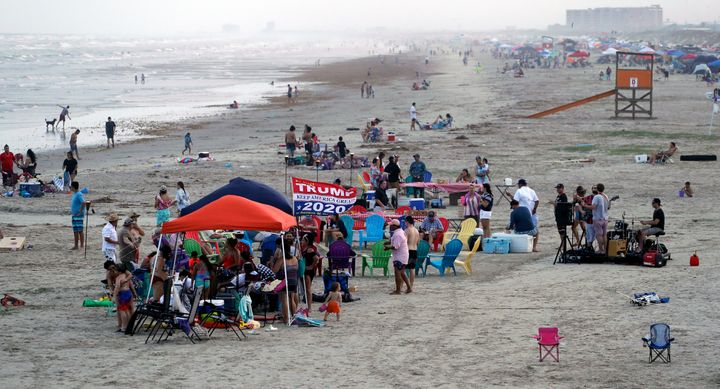 People gather on the beach for the Memorial Day weekend in Port Aransas, Texas, Saturday, May 23, 2020. Beachgoers are being