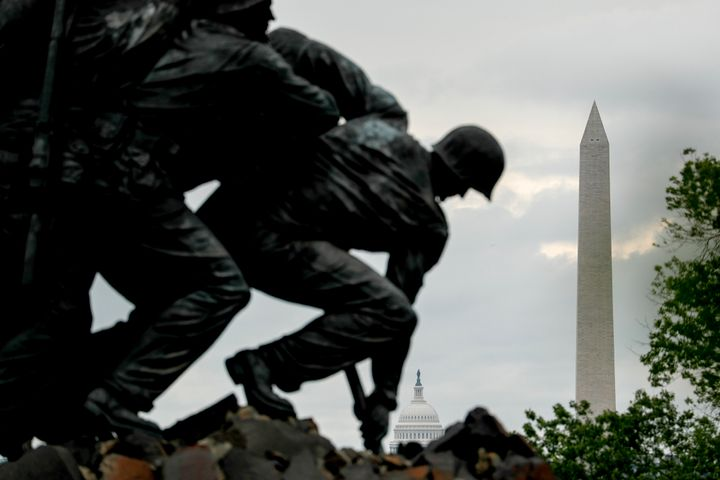 The Dome of the U.S. Capitol Building and the Washington Monument are visible behind the U.S. Marine Corps War Memorial on Me