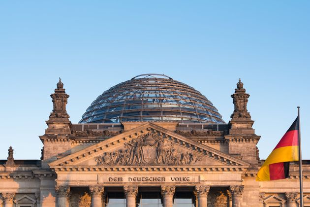 German flag fluttering front of Reichstag building. Berlin,