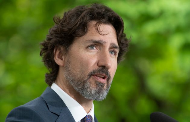 Prime Minister Justin Trudeau responds to a question from a member of the media on site during a daily...