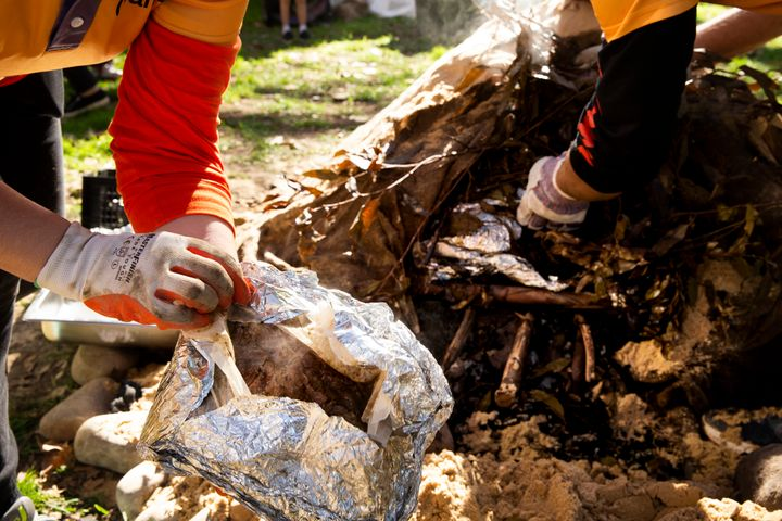 SYDNEY, AUSTRALIA - JULY 13: An earth oven is dug up at Hyde Park on July 13, 2019 in Sydney, Australia. NAIDOC Week celebrations are held across Australia each year to celebrate the history, culture and achievements of Aboriginal and Torres Strait Islander peoples. NAIDOC is celebrated not only in Indigenous communities, but by Australians from all walks of life. (Photo by Jenny Evans/Getty Images)