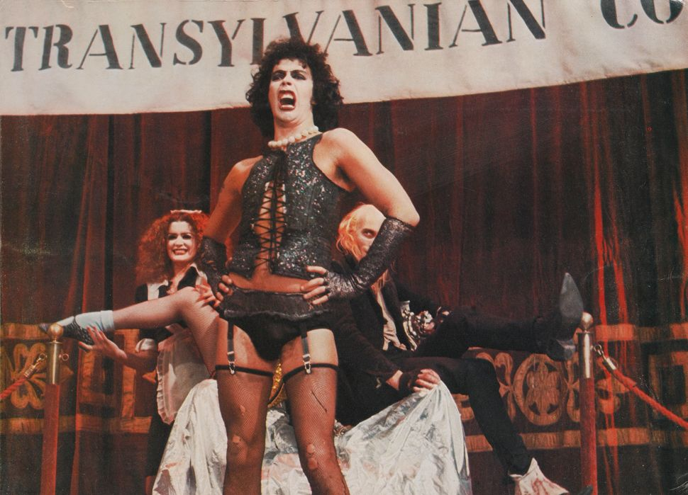 """Tim Curry, backed by Patricia Quinn and Richard O'Brien, in """"The Rocky Horror Picture Show."""""""