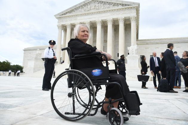Transgender activist Aimee Stephens sits in her wheelchair outside the Supreme Court in Washington, D.C.,...