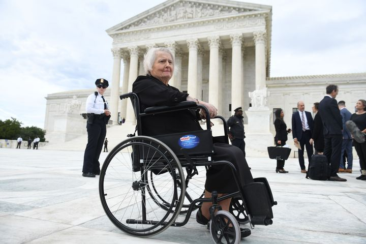 Transgender activist Aimee Stephens sits in her wheelchair outside the Supreme Court in Washington, D.C., October 8, 2019.