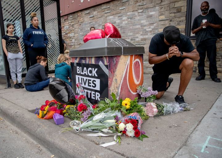 Many carried flowers and placed them near the site where George Floyd, a middle-aged Black man, died after a confrontation with Minneapolis police.