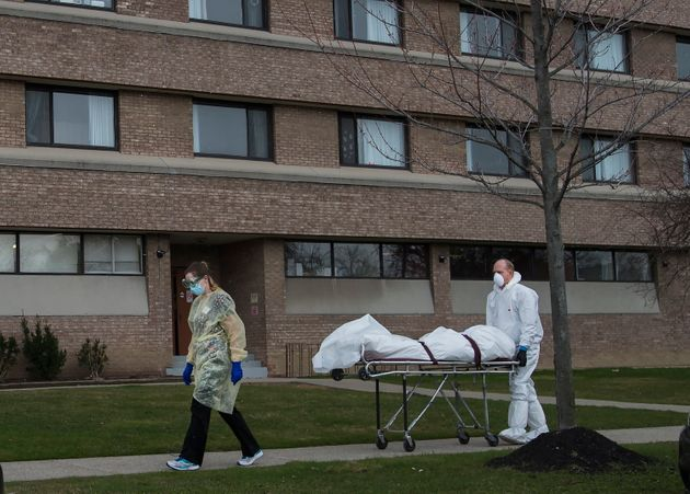 A body is wheeled from the Eatonville Care Centre in Etobicoke, Ont. during the COVID-19 pandemic on...