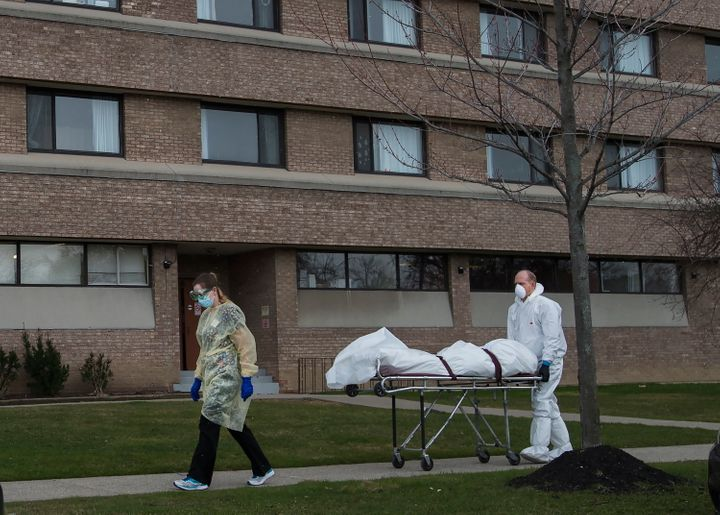 A body is wheeled from the Eatonville Care Centre in Etobicoke, Ont. during the COVID-19 pandemic on April 14, 2020.