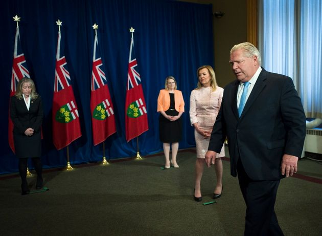 Ontario Premier Doug Ford leaves the podium after answering questions about a disturbing report from...