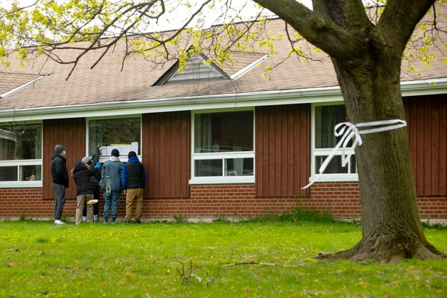 A resident at Altamont Care Community in Scarborough, Ont. receives a Mother's Day visit from her family...