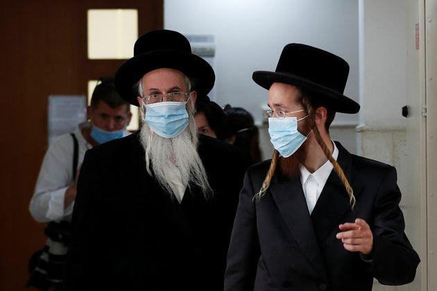 Ultra-Orthodox Jewish men, family members of Malka Leifer, a former Australian school principal accused...