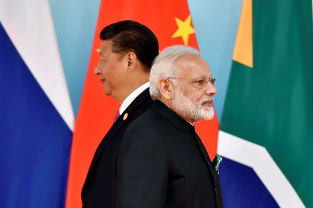 Chinese President Xi Jinping and Prime Minister Narendra Modi at the group photo session during the BRICS...