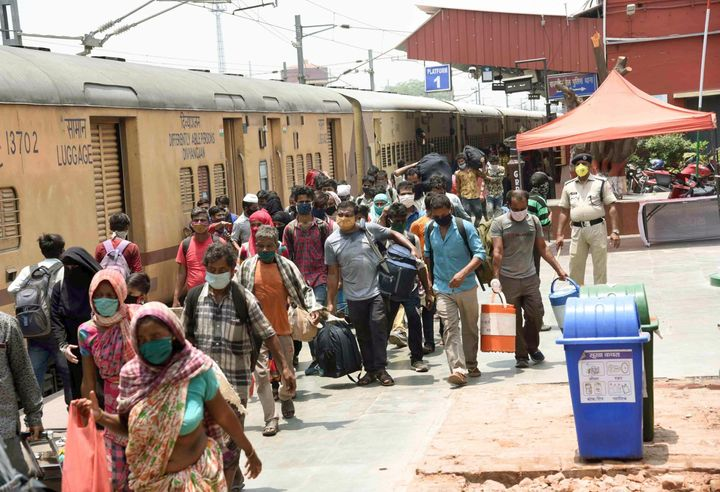 Migrants leave after arriving by a Shramik special train at Danapur station, on May 25, 2020 in Patna, India.