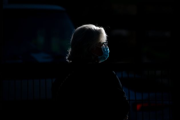 A woman with a face mask waits for the bus, on May 14, Santiago Chile. (Photo by Matias Basualdo/NurPhoto...